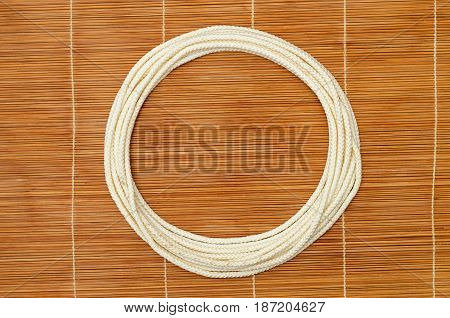 white rope ring on a wooden background