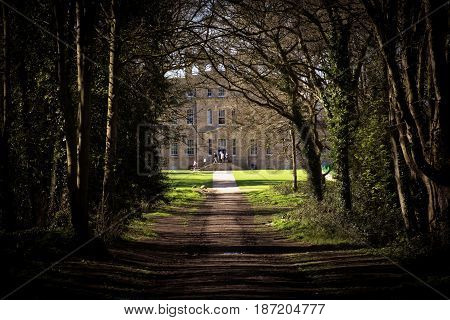 Bristol UK - April 02 2017: Kings Weston House South East or Garden front entrance front across the lawns. Kings Weston House is a historic building in Bristol England. It was built between 1712 and 1719 was designed by Sir John Vanbrugh.