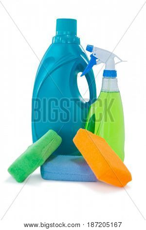 Colorful sponges with bottles against white background
