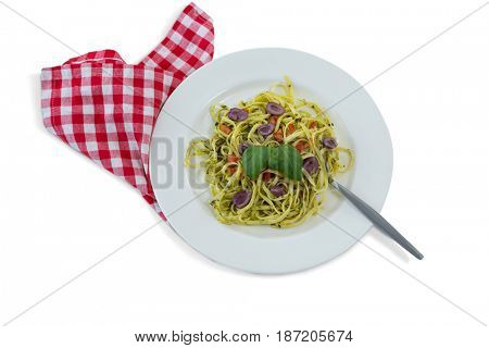 Overhead view of pasta served in plate against white background