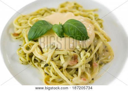 Close up of fettuccine served in plate over white background