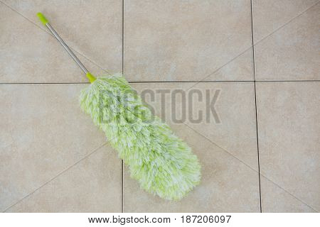 High angle view of duster on tiled floor