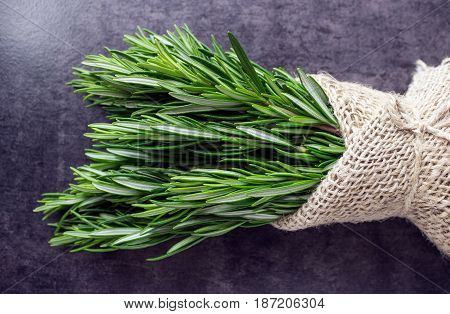 Bouquet of fresh rosemary in burlap bag tied with twine. Spices. Healthy eating.