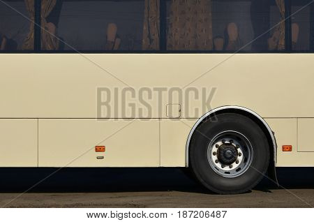 Photo Of The Hull Of A Large And Long Yellow Bus With Free Space For Advertising. Close-up Side View
