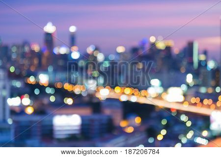 Night blurred bokeh city office building with twilight sky background