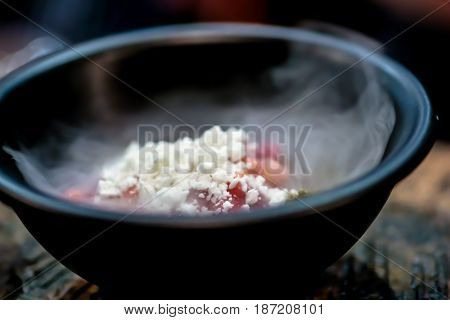 The Dessert Of Berries With Dry Ice, In A Black Plate. Smoke From Ice. Molecular Cuisine.