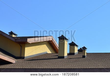 Modern Roofing And Decoration Of Chimneys. Flexible Bitumen Or Slate Shingles. The Absence Of Corros