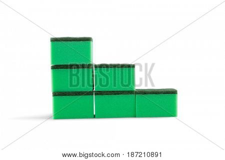 Stack of cleaning sponges against white background