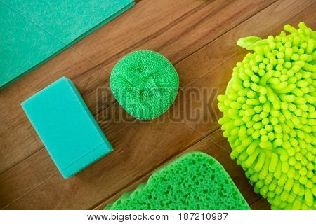 Close-up of soap by sponge on wooden table