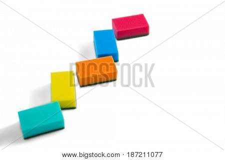High angle view of colorful cleaning sponges against white background