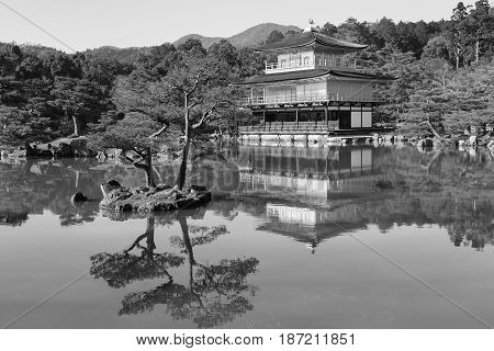 Black and White Kinkaku-ji called Golden Pavilion is a Zen Buddhist temple with reflection Kyoto Japan.