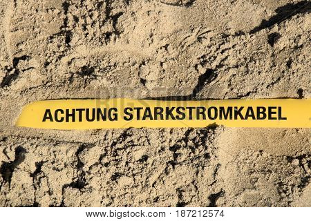 Achtung Starkstromkabel, high voltage cables in ground
