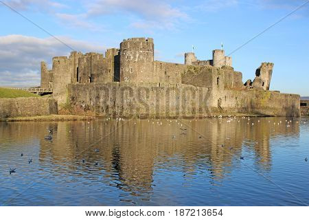 Caerphilly castle reflected in a lake, Wales