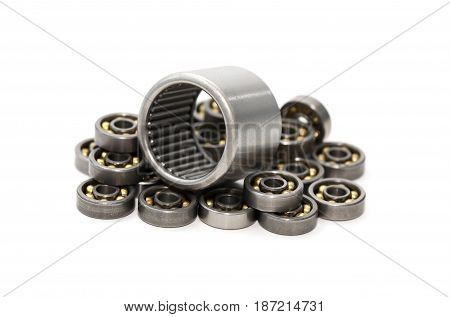 Industrial concept. Set of small ball bearings on white background