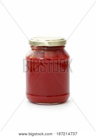 Glass jar with tomato paste isolated on white background. Clipping path is included
