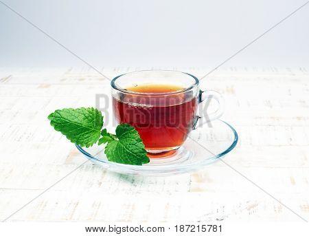 Tea. Herbal Tea. Mint Leaf. Tea In A Glass Cup, Mint Leaves, Dried Tea, Sliced Lime. Herbs On A Slat