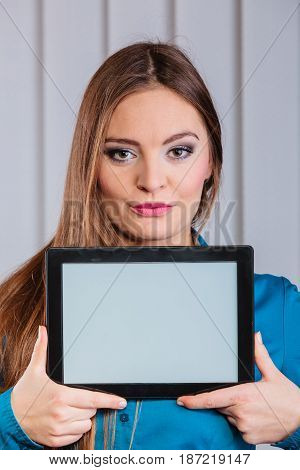 Technology help in career business and work advertisement. Young woman hold tablet portable computer show advice and help.