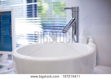 Close-up of washbasin at dental clinic