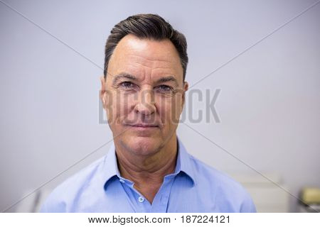 Portrait of smiling dentist in clinic