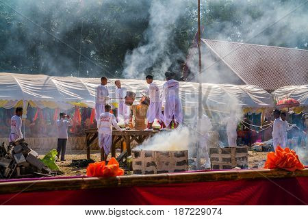 BURIRAM THAILAND - JAN 2 : Buddhist metal cast ceremony for buddha statue Pouring molten metal in mold . Jan 22017 in Lok Molee Temple Buriram Thailand.