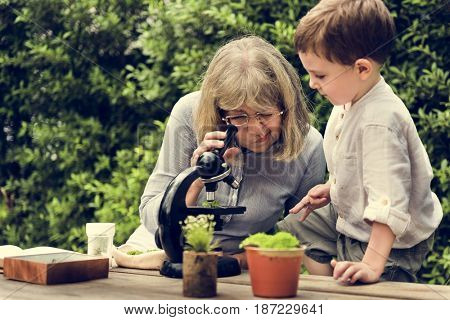 Little Kid Experimenting Science Microscope