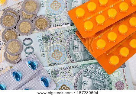 Pills and polish zloty bills. medicine pills health cost polish money zloty pln concept