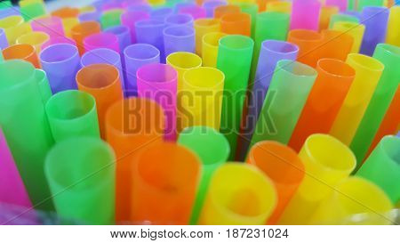 Focus on Colored plastic drinking straws in the box