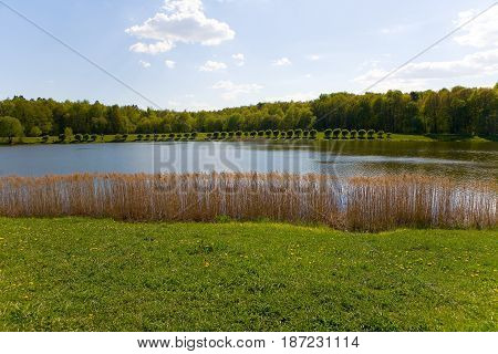 Izmailovsky Park with a pond in Moscow in the spring. Russian landscape.