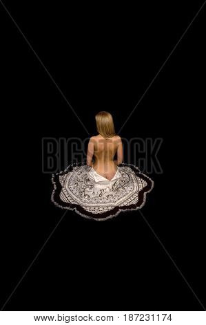Thumbelina. The half-naked girl is blonde in an unbuttoned skirt on a black background.