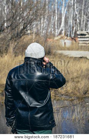 Man talking on the phone. Rural life.