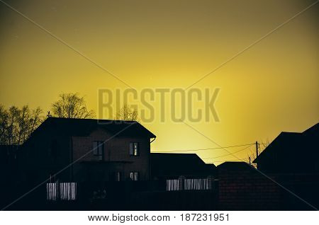 Country side house in the light of sunset.