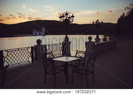 beautiful terrace with tables cafe near the lake