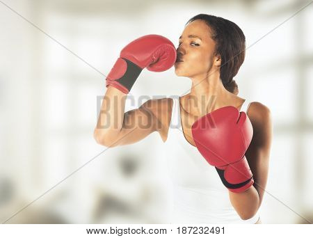 Young athletic woman in boxing gloves on a white background