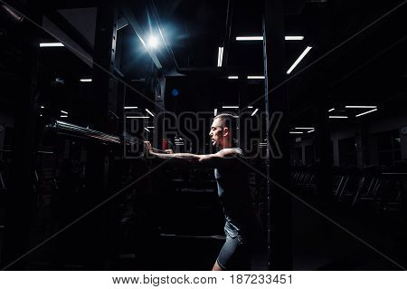 Cross Training. Part Of Young Man In Sportswear Lifting Barbell At Gym