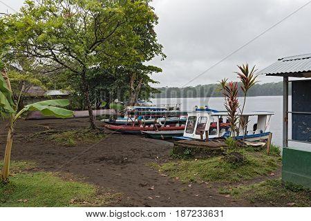 TORTUGUERO, COSTA RICA-MARCH 21, 2017:  Boats at the pier in Tortuguero, Costa Rica