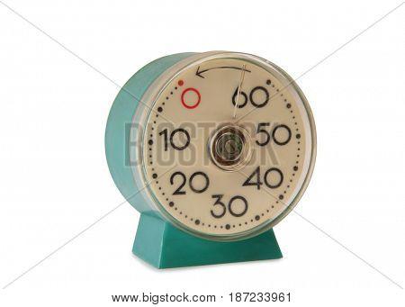 Old mechanical alarm clock on white background
