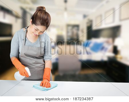asian housewife sweeping on table in bedroom