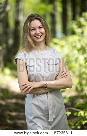 Happy woman walking in the summer park