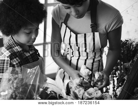 Mom Teaching Kid about Flowers in Flora Shop