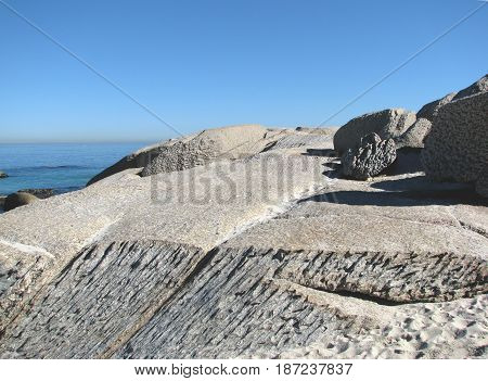 CLIFTON, CAPE TOWN, SOUTH AFRICA, HUGE UNUSUALLY SHAPED BOULDERS IN FORE GROUND AND THE OPEN SEA AND SKY IN THE BACK GROUND