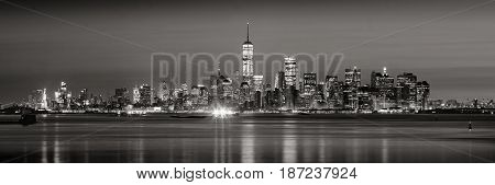 Panoramic view of Lower Manhattan Financial District skyscrapers in Black & White at dawn from New York City Harbor