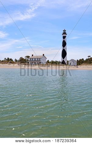 Cape Lookout Lighthouse on the Southern Outer Banks or Crystal Coast of North Carolina viewed from the water vertical
