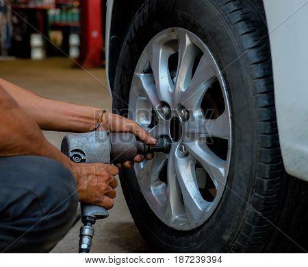 tightening bolts of car wheel by tightening machine.