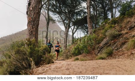 Couple Of Runners Working Out In Beautiful Nature