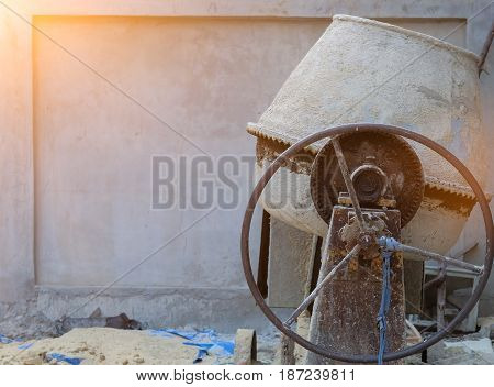 Concrete-mixer is left after working time at construction site.