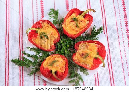 The Stuffed Red Pepper Strewed With Cheese And Decorated With Greens