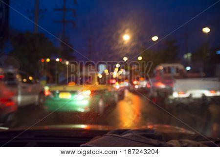 Blur Image. Traffic Light In The Night.