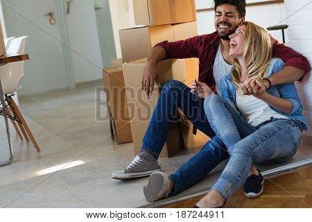 home, people, moving and real estate concept - couple in love moving in new apartment