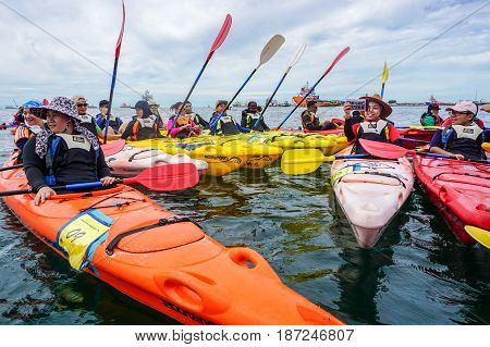 Labuan,Malaysia-Feb 19,2017:Group of adventurer enjoying a weekend kayaking in Labuan island,Malaysia.Malaysia is the ideal place for water sports,like white water rafting,kayaking & scuba diving