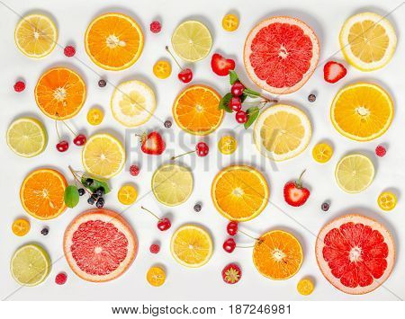Flat Lay Trendy Seamless Pattern Sliced Mixed Citrus Fruits Like Background With Different Berries,
